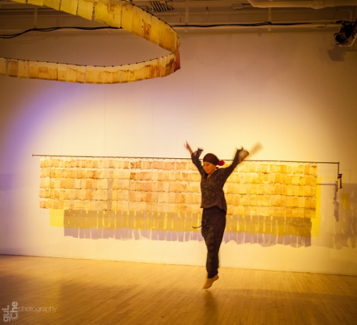 Sabine Heubusch dancing an Indian tea story from Michele Brody's installation.