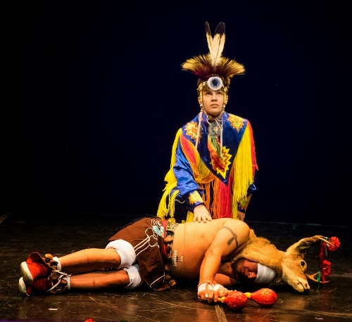 POW-WOW—Hunter (Ciaran Tufford, Mayan/Cherokee) blesses his prey (Carlos Ponce, Mayan) in Deer Dance in Thunderbird American Indian Dancers' Dance Concert and Pow-Wow, presented by Theater for the New City January 31 to February 9, 2014.