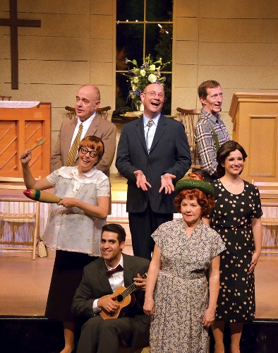 Everything You'll Need: The Rev. Mervin Oglethorpe (John Vessels), center, sings 'Everything You'll Need' with the Singing Sanders Family (from left) Burl Sanders (Bob Payne), June Sanders (Sarah Hund), Dennis Sanders (Will Boyajian), Vera Sanders (Pam Pendleton), Dennis Sanders (Brian Gunter) and Denise Sanders Culpepper (Christina Rose Rahn) in Beef & Boards Dinner Theatre's production of Smoke on the Mountain: Homecoming. This sequel in the popular bluegrass gospel series is on stage through Aug. 16. Tickets include Chef Odell Ward's dinner buffet.