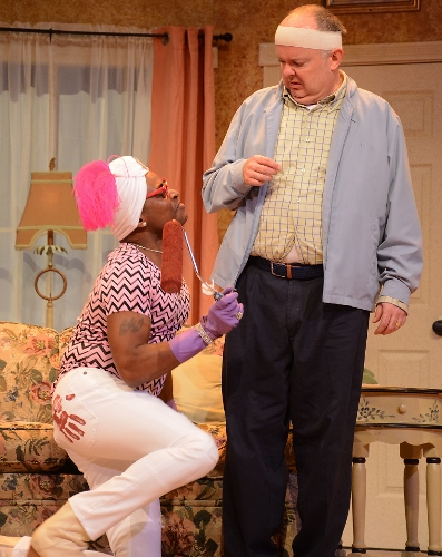 Bobby Franklyn (Sean Blake), left, the eccentric upstairs neighbor of John Smith (Eddie Curry), right, implores him to see if spilled paint from the apartment upstairs has seeped through the ceiling in Smith's Streatham flat in Beef & Boards Dinner Theatre's production of 'Run for Your Wife.'