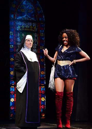 Deloris Van Cartier (Zuri Washington), right, introduces herself to the strict Mother Superior (Suzanne Stark), who is not happy that the lounge singer, who just witnessed a murder, will be hiding in her convent in Beef & Boards Dinner Theatre's production of Sister Act, now on stage through March 25. Broadway's divine musical comedy is based on the film of the same name that starred Whoopi Goldberg in the role of Deloris.