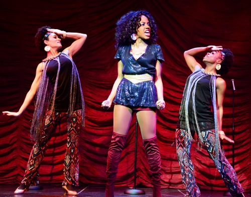 "Disco diva wannabe Deloris Van Cartier (Zuri Washington), center, sings about her aspirations in ""Fabulous Baby"" with backup singers Michelle (Amy Owens), left, and Tina (Ayana Major Bey) in Beef & Boards Dinner Theatre's production of Sister Act, now on stage through March 25. Broadway's divine musical comedy is based on the film of the same name that starred Whoopi Goldberg in the role of Deloris."