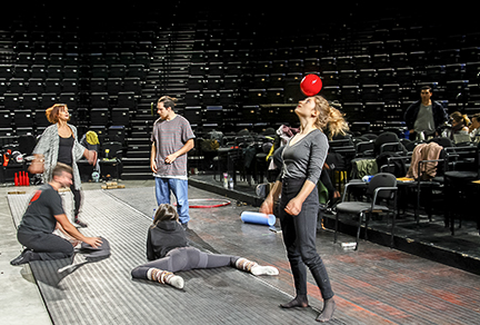 Young performers of Montreal's Les 7 Doigts de la Main circus troop receive notes and warm up at a rehearsal.