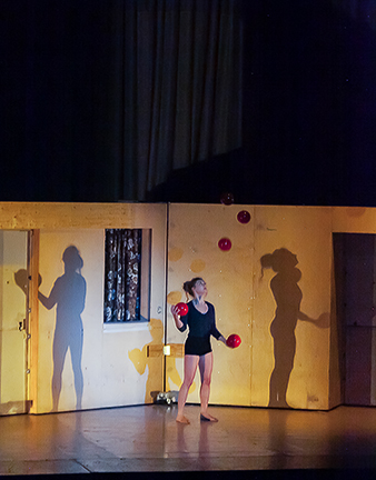 A juggler/dancer/actress rehearses the next show.