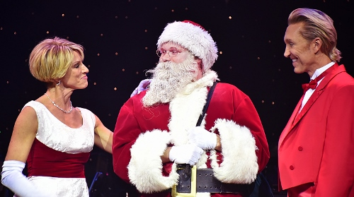 Co-hosts Deb Wims and Kenny Shepard join Santa Claus on stage in A Beef & Boards Christmas, now on stage through Dec. 23.