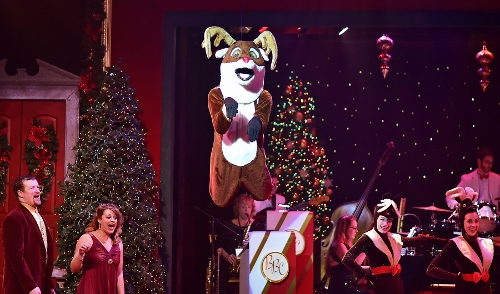 Rudolph flies overhead in A Beef & Boards Christmas, now on stage through Dec. 23.