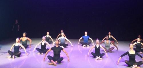 Dancers doing Graham floor work.