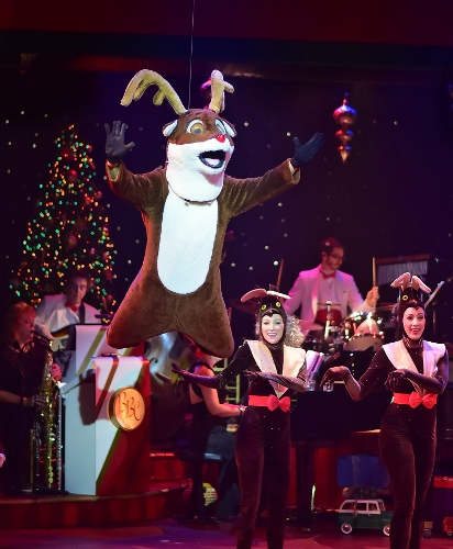 Rudolph soars overhead in the 25th Annual A Beef & Boards Christmas, now on stage at Beef & Boards Dinner Theatre.
