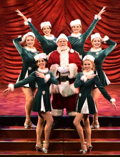 Santa is joined by some snappy dancers on stage in the 25th Annual A Beef & Boards Christmas, now on stage at Beef & Boards Dinner Theatre.