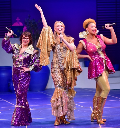 The Dynamos (from left) Rosie (Lanene Charters), Donna (Amy Bodnar), and Tanya (Jalynn Steele) reunite in Beef & Boards Dinner Theatre's production of Mamma Mia! Now on stage, the Broadway mega-hit musical features the songs of the Swedish super group, ABBA, tells the story of a bride's search for her birth father on a Greek island paradise.