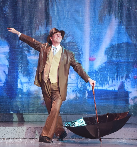 "Singin' in the Rain: Don Lockwood (Timothy Ford), doesn't mind the downpour as he's ""Singin' in the Rain"" during Beef & Boards Dinner Theatre's production of 'Singin' in the Rain,' now on stage through May 26."