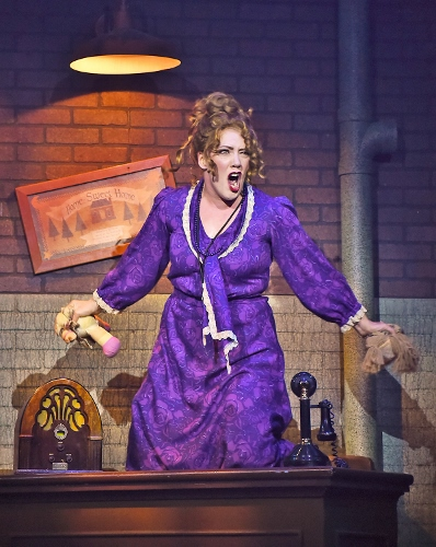 "Little Girls1: Miss Hannigan (Kelly Teal Goyette) is distraught over her life that's filled with ""Little Girls"" in Beef & Boards Dinner Theatre's production of Annie, now on stage through July 15."
