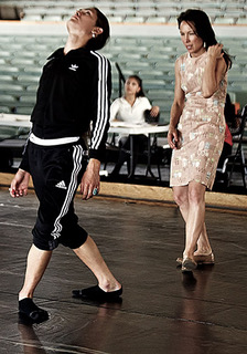"Dancer Jasper Shorty and choreographer Emily Johnson rehearse onstage for a performance of ""Dr. Atomic"" at the Santa Fe Opera."