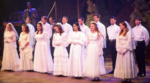 "The seven Pontipee brothers marry their brides in Seven Brides for Seven Brothers, now on stage at Beef & Boards Dinner Theatre through Oct. 7. This rip-roaring stage version of the classic MGM film is bursting with energetic dance numbers and famous songs including ""Wonderful, Wonderful Day,"" ""Bless Your Beautiful Hide,"" and ""Goin' Courting."""