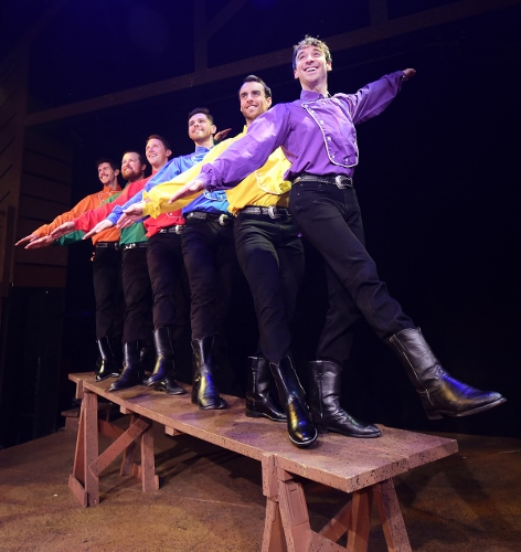 "The six remaining single Pontipee brothers show off at the town social in Seven Brides for Seven Brothers, now on stage at Beef & Boards Dinner Theatre through Oct. 7. This rip-roaring stage version of the classic MGM film is bursting with energetic dance numbers and famous songs including ""Wonderful, Wonderful Day,"" ""Bless Your Beautiful Hide,"" and ""Goin' Courting."""