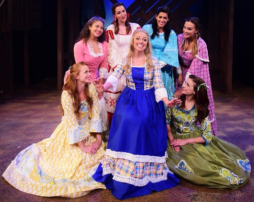 "Milly (Krista Severeid), center, tells her friends that she's going to marry Adam Pontipee as she sings ""Wonderful, Wonderful Day"" in Seven Brides for Seven Brothers, now on stage at Beef & Boards Dinner Theatre through Oct. 7. This rip-roaring stage version of the classic MGM film is bursting with energetic dance numbers and other famous songs include ""Bless Your Beautiful Hide,"" and ""Goin' Courting."""