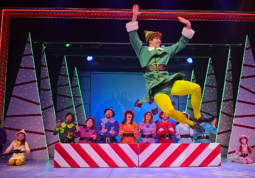 "Buddy (Dan Bob Higgins) kicks up his heels as he sings that he's ""Happy All The Time"" in Christmastown at the North Pole in Beef & Boards Dinner Theatre's production of Elf, The Musical, now on stage through Dec. 31."