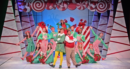 "After showing the staff how to decorate properly for Christmas, Buddy (Dan Bob Higgins), center, explains everything must be ""Sparklejollytwinklejingly"" in Beef & Boards Dinner Theatre's production of Elf, The Musical, now on stage through Dec. 31."