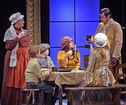 The Cratchit family toasts before their Christmas dinner in Beef & Boards Dinner Theatre's production of A Christmas Carol, on stage select dates through Dec. 21.