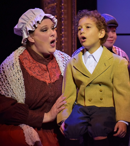 "Tiny Tim (Ashton Curry), right, sings ""Silent Night"" with his mother, Mrs. Cratchit (Rebecca DeVries) in Beef & Boards Dinner Theatre's production of A Christmas Carol, on stage select dates through Dec. 21."