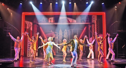 The cast performs the title number in 42nd Street at Beef & Boards Dinner Theatre. The Tony Award-winning musical is now on stage through May 19.