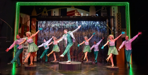 "Billy Lawlor (Dan Bob Higgins), center, leads a show stopping performance of ""We're in the Money"" in 42nd Street at Beef & Boards Dinner Theatre. The Tony Award-winning musical is now on stage through May 19."