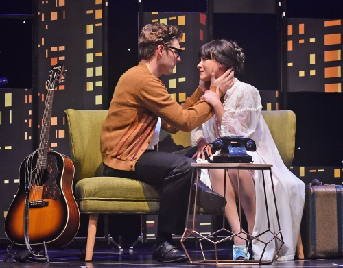 "Buddy Holly (Kyle Jurassic), left, reassures his wife Maria Elena (Kelly Powers-Figueroa) after she had a nightmare in Beef & Boards Dinner Theatre's production of Buddy: The Buddy Holly Story, now on stage. This high-energy musical features Buddy's greatest hits including ""Oh Boy,"" ""Peggy Sue,"" and ""Everyday."""