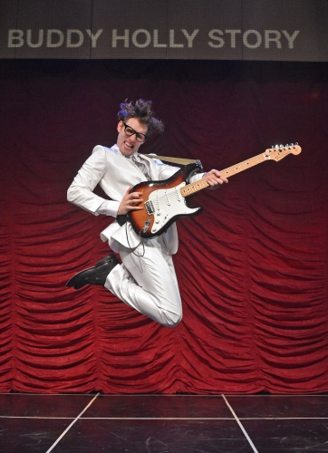 "Kyle Jurassic plays the iconic title role in Beef & Boards Dinner Theatre's production of Buddy: The Buddy Holly Story, now on stage. This high-energy musical features Buddy's greatest hits including ""Oh Boy,"" ""Peggy Sue,"" and ""Everyday."""