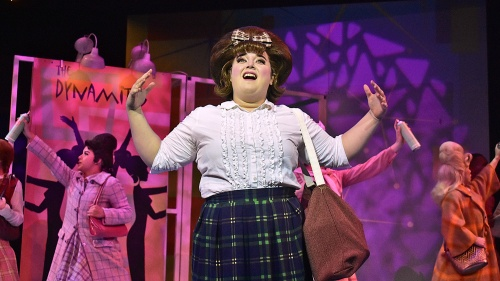 "Tracy Turnblad (Adee David), center, sings ""Good Morning Baltimore"" in Beef & Boards Dinner Theatre's production of Hairspray, now on stage through Oct. 6. Broadway's big, bold, beautiful hit won eight Tony Awards, including Best Musical."