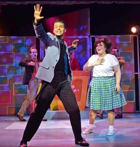 "Link Larkin (Nate Willey), front, sings ""It Takes Two"" to Tracy Turnblad (Adee David), right, in Beef & Boards Dinner Theatre's production of Hairspray, now on stage through Oct. 6. Broadway's big, bold, beautiful hit won eight Tony Awards, including Best Musical."