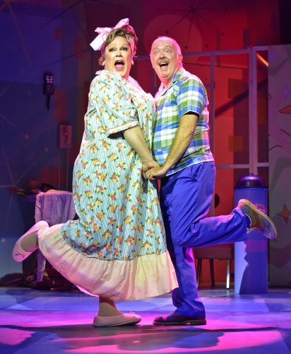 "Edna Turnblad (Daniel Klingler), left, and Wilbur Turnblad (Eddie Curry) sing ""You're Timeless To Me"" in Beef & Boards Dinner Theatre's production of Hairspray, now on stage through Oct. 6. Broadway's big, bold, beautiful hit won eight Tony Awards, including Best Musical."