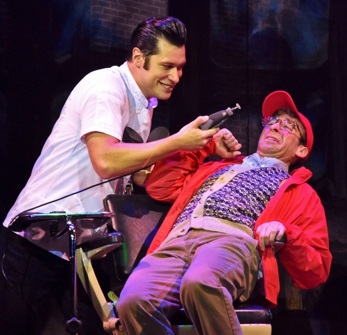 The sadistic dentist Orin Scrivello DDS (Logan Moore) shows his rusty antique drill to Seymour (Joey Boos) in Beef & Boards Dinner Theatre's production of Little Shop of Horrors, now on stage through Nov. 17.