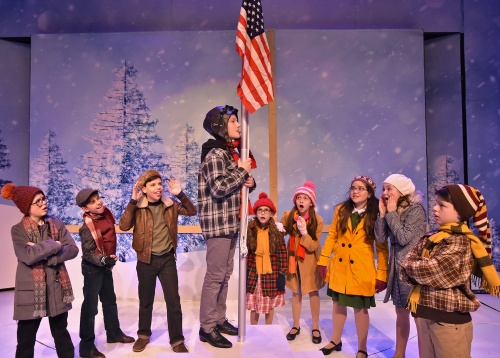 After being triple dog dared by Schwartz (Locklan Gardner), far right, Flick (Jack Clark) touches his tongue to the icy flagpole where it becomes stuck in Beef & Boards Dinner Theatre's production of 'A Christmas Story: The Musical'.