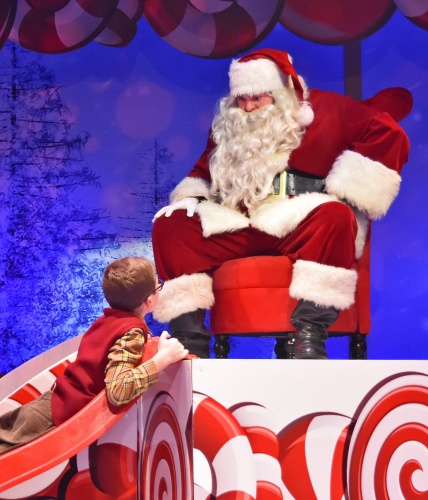After having his mind go blank on the lap of Santa (Brett Mutter), Ralphie (Ben Kistner) crawls back up the slide to get his Christmas request right in Beef & Boards Dinner Theatre's production of 'A Christmas Story: The Musical'.