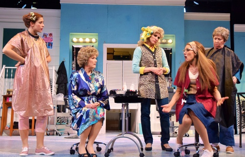 Annelle (Morgan Jackson), second from right, tells the ladies at Truvy's beauty shop about her desperate circumstances in Beef & Boards Dinner Theatre's production of 'Steel Magnolias.'