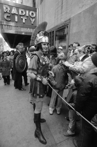 Rosie in armor, 'Fighting to Save Radio City Music Hall from Demolition' while soliciting signatures and public support, April 2, 1978.