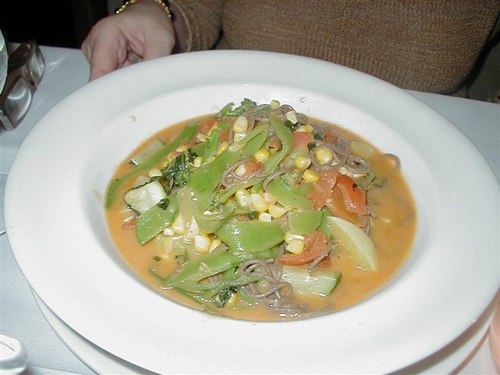 Fresh garden vegetables simmered in a Thai coconut curry broth with soba noodles