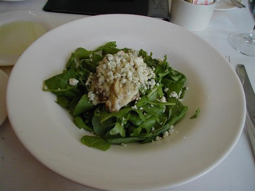 Arugula with caramelized poached pear, melted gorgonzola cheese, and macadamia sherry vinaigrette