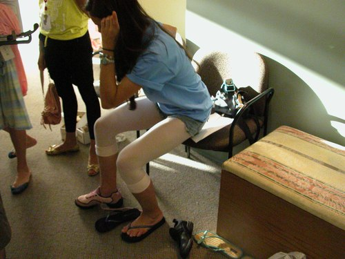 Trying on a pair of pink split-sole dance sneakers