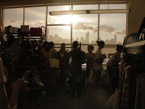 The line at the cash register with the silhouetted skyline