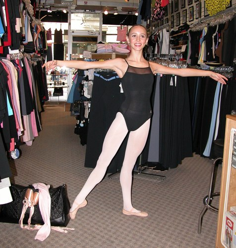 Black ABT Leotard by Capezio. Black quilted satin bag by Capezio. Modeled by Skylar Brandt. Available at <a href='http://www.onstagedancewear.com'>OnStageDancewear.com</a>.