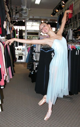 Aqua dress by OnStageDancewear.com. Modeled by Skylar Brandt. Available at <a href='http://www.onstagedancewear.com'>OnStageDancewear.com</a>.