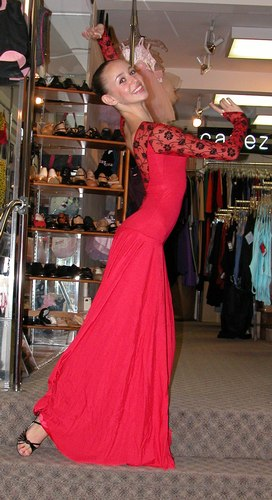 Red dress with black lace accents by Star Styled. 'Tara' shoes by Freed of London. Modeled by Skylar Brandt. Available at <a href='http://www.onstagedancewear.com'>OnStageDancewear.com</a>.