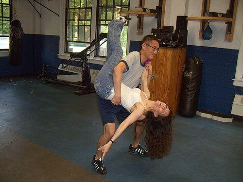 The training pictures in the USMMA aerobics area have been great memories for me... Midshipman Yoo decides... 'You know... Coach Marcy is making me work hard. I think I will flip her. Yes, and I cannot get in trouble for this one- it's just practice!'