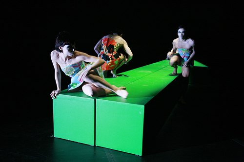 Cedar Lake Contemporary Ballet performs 'Rite' by Stijn Celis.  Dancers: Acacia Schachte, Oscar Ramos (back) and Jon Bond