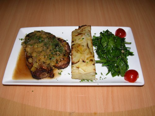 Pineapple roasted pork chops, potatoes, spinach, tomatoes