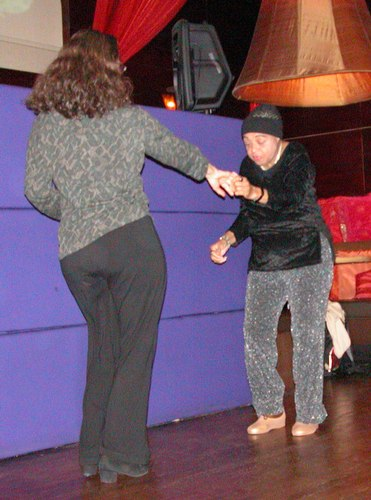 Dawn Hampton (on right) dances West Coast Swing at Taj