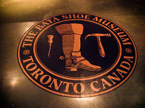 Imprinted into the floor is the logo of Toronto's Bata Shoe Museum.