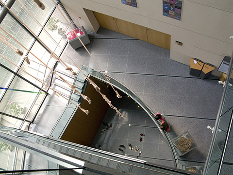 A mobile of ballet slippers are suspended by their satin ribbon ties in the atrium of the Bata Shoe Museum, Toronto, Canada.