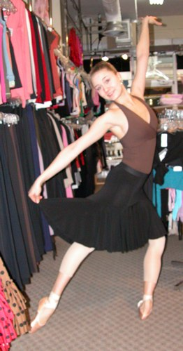 Cecilia is wearing a Black Flared Skirt by Body Wrappers, Style 7641, $39.99; and a Halter Leotard from the Premiere Collection by Body Wrappers, Style P802, $48.99. Available at <a href='http://www.onstagedancewear.com'>OnStageDancewear.com</a>.